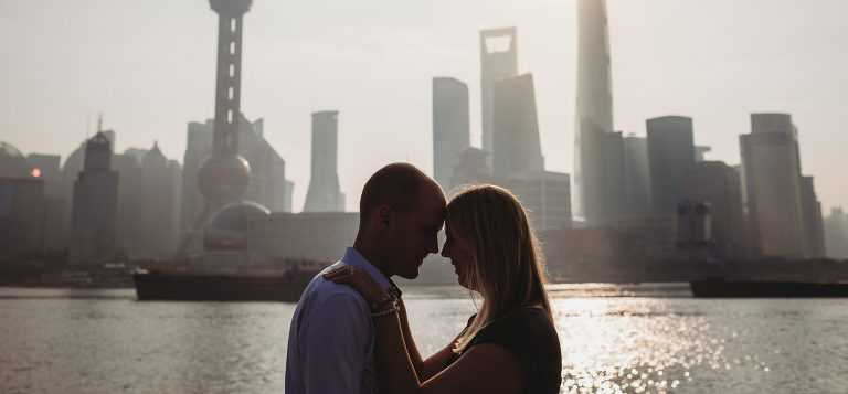 Portrait of a couple in front of Shanghai skyline
